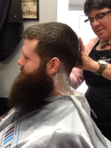 Even though the beard's length isn't touched,  Joshua keeps his hair style neat and short.